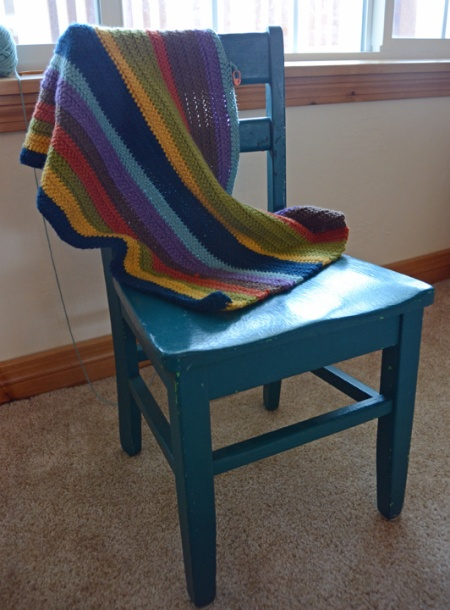 Blanket and blue chair